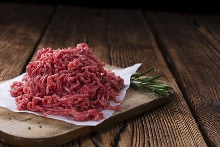 minced beef: Minced Meat (close-up shot) on vintage wooden background