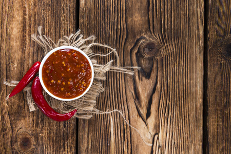Sambal Oelek (fresh made) on wooden background