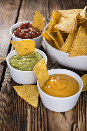 nacho: Three different nacho dips (Salsa, Cheese and Guacamole)