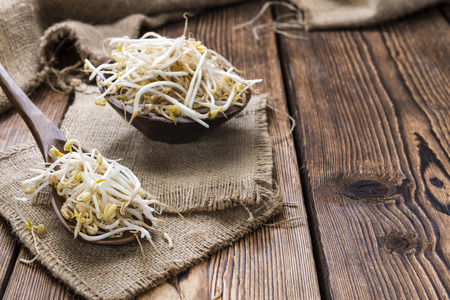 beansprouts: Mungbean Sprouts (close-up shot) on wooden background Stock Photo