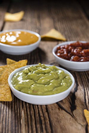 nacho: Different sorts of Nacho Dips (soft focus) on wooden background