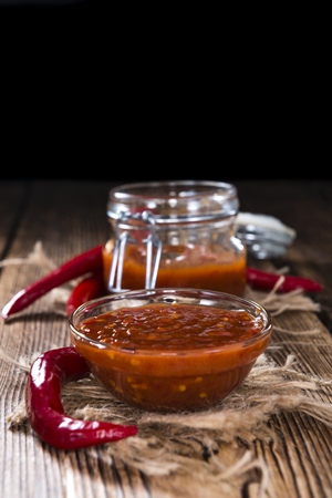 sambal: Homemade Sambal Oelek (close-up shot) on wooden background