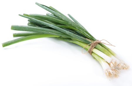 scallions: Fresh Scallions isolated on white background (close-up shot)