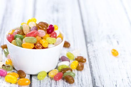 colorfull: Heap of colorfull Jelly Beans (on bright wooden background)