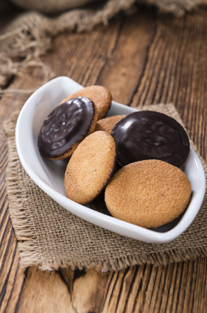 jaffa: Some Jaffa Cakes (close-up shot) on rustic wooden background