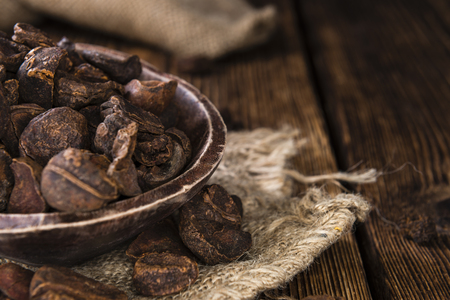 ones: Dried Cola Nuts (whole ones) on vintage wooden background Stock Photo