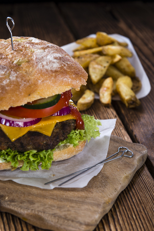 ciabatta: Fresh made Ciabatta Burger with chips on vintage wooden background