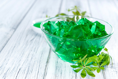 sweet woodruff: Portion of Woodruff Jelly on a bright wooden background