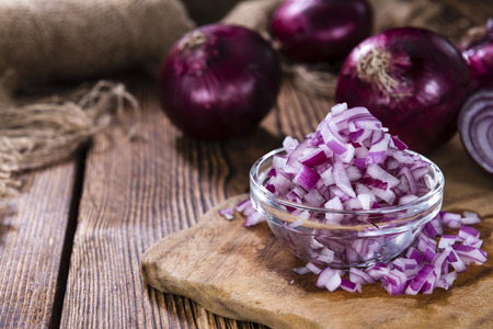 red onions: Small bowl with (diced) Red Onions on wooden background Stock Photo