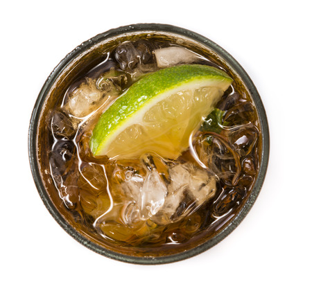 longdrink: Fresh made Cuba Libre isolated on white background with brown rum and lime