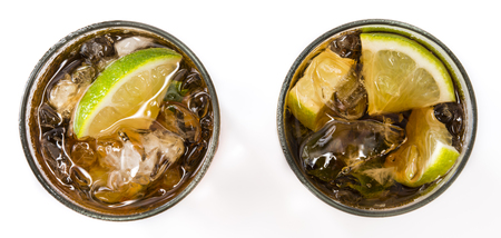 longdrink: Fresh made Cuba Libre (isolated on white background) with brown rum and lime Stock Photo