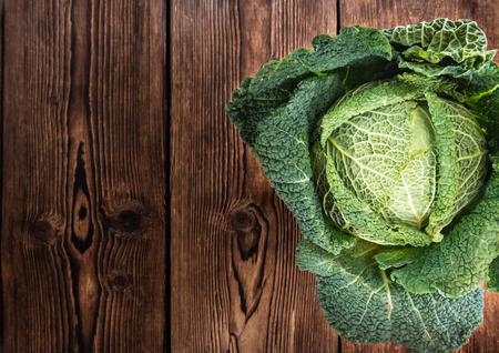 savoy cabbage: Savoy Cabbage (close-up shot) on wooden background Stock Photo