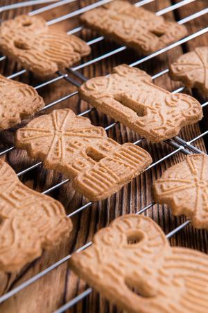 speculaas: Heap of fresh baked Spekulatius (German cuisine) on wooden background