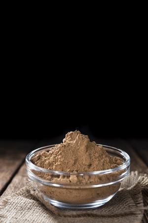 energizing: Portion of Guarana Powder on dark wooden background