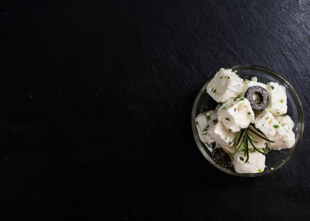 greek: Greek Feta Cheese on a slate slab background (close-up shot)