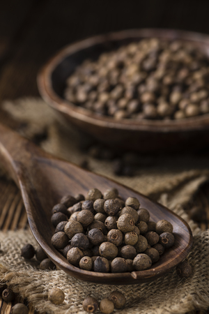 allspice: Portion of Allspice (detailed close-up shot) on wooden background