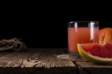 grapefruit juice: Fresh Grapefruit Juice on rustic wooden background (close-up shot)
