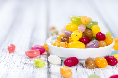 jellybean: Heap of colorfull Jelly Beans (on bright wooden background)
