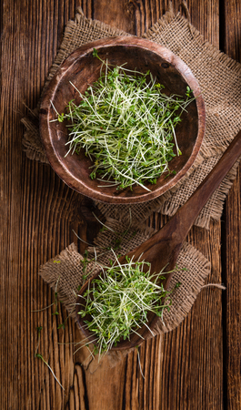 cress: Portion of Cress (close-up shot) on rustic wooden background