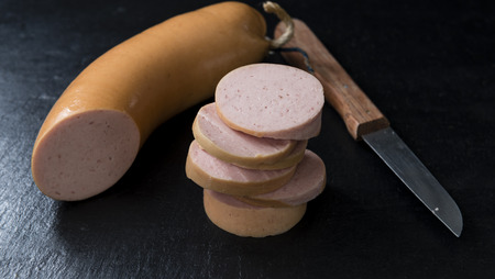 bologna baloney: Portion of Baloney on rustic wooden background (close-up shot) Stock Photo