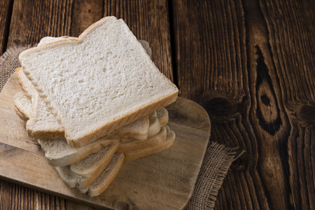 wheat toast: Slice of toast bread (selective focus) on wooden background Stock Photo