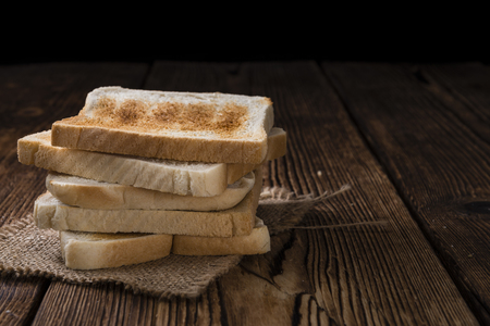 wheat toast: Crispy Toast Bread (selective focus) on wooden background Stock Photo
