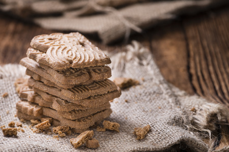 Heap of fresh baked Spekulatius (German cuisine) on wooden background