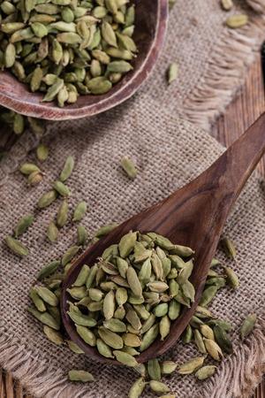 cardamon: Cardamon Seeds on wooden background (close-up shot)