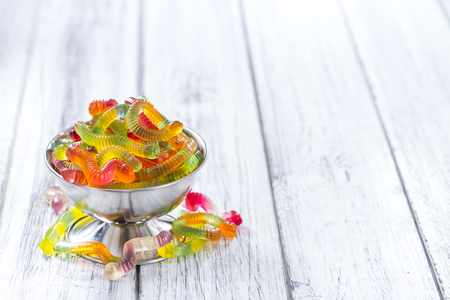 gummi: Gummi Candy (worms) on wooden background (selective focus)