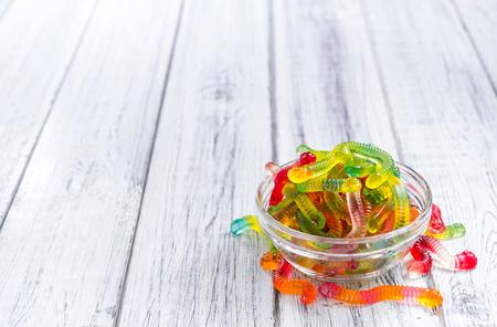 gummi: Portion of Gummi Candy (close-up shot) on wooden background