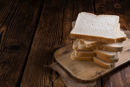 wheat toast: Sliced Toast Bread (selective focus) on vintage wooden background