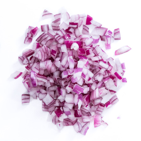 Portion of diced Red Onion (detailed close-up shot) isolated on white background