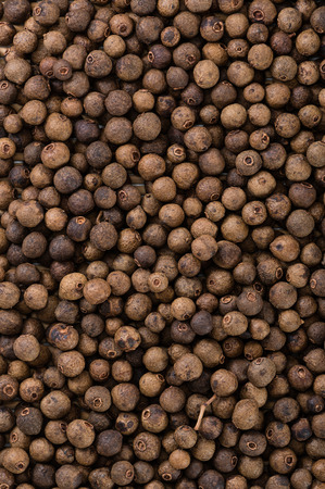 Heap of dried Allspice for use as background image or as texture Stock Photo
