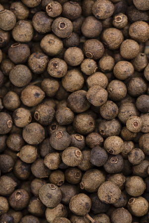 elective: Heap of dried Allspice for use as background image or as texture Stock Photo