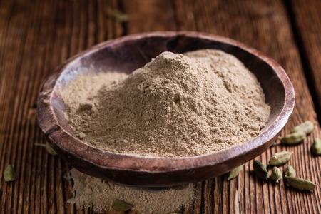 cardamon: Cardamon Powder on wooden background (detailed close-up shot)