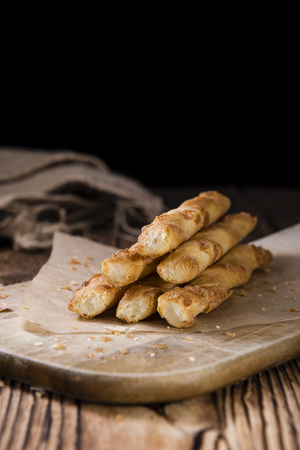 french bakery: Portion of Pastry Sticks (close-up shot) on a vintage background