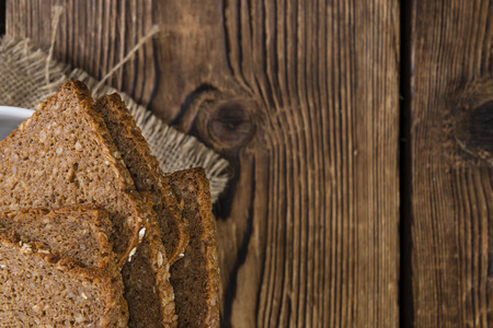 brown bread: Brown Bread (sliced) on an old wooden table (selective focus)