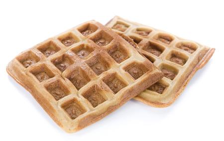Fresh made Waffles (close-up shot) isolated on pure white background