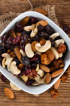 berry: Wooden table with Trail Mix (selective focus, close-up shot)