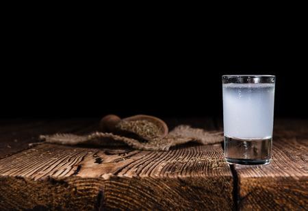 Frozen Ouzo (Greek aperitif) on vintage wooden background