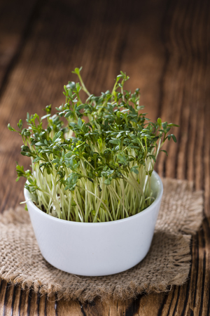 cress: Fresh Cress (close-up shot) on rustic wooden background