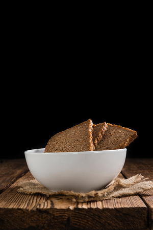 brown bread: Slices of  Brown Bread (selective focus) on an old wooden table