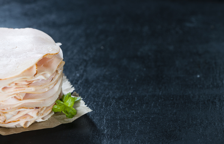 Heap of sliced Chicken Breast Fillet (selective focus; close-up shot)