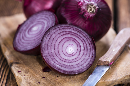 red onions: Red Onions (close-up shot) on an old rustic wooden table