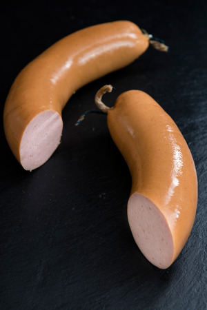 bologna baloney: Sliced Baloney (close-up shot) on dark wooden background