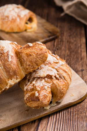 traditionally french: Homemade Ham and Cheese Croissant (selective focus) on wooden background