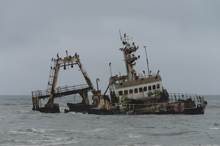shipwreck: Shipwreck at the Skelleton Coast (Namibia) during a stormy day
