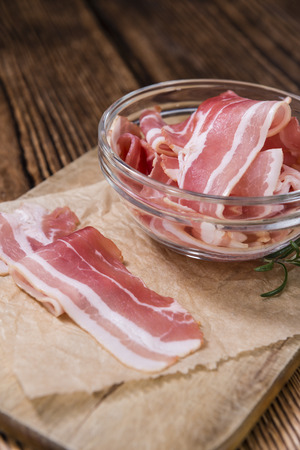 raw bacon: Raw Bacon slices (detailed close-up shot) on vintage wooden background