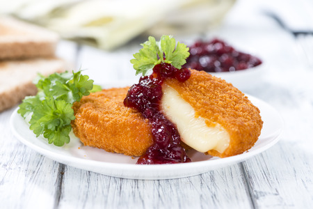 Fried Camembert (selective focus) with Cranberry sauce Stock Photo