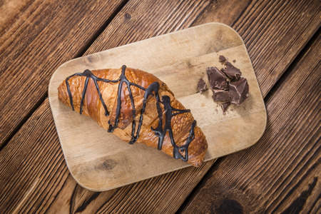 traditionally french: Sweet Chocolate Croissants (selective focus) on vintage wooden background